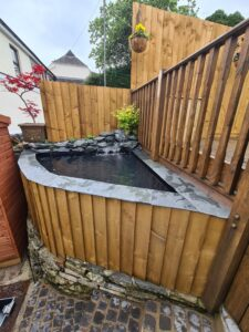 Raised Wooden Pond With A Waterfall